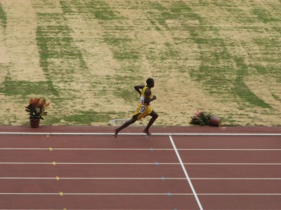 """2007 Special Olympics World Summer Games: """"I know I can"""". Team Tanzania athlete flies over the finish line.... and keeps running"""
