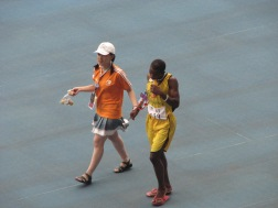 2007 Special Olympics World Summer Games: Team Tanzania athlete closely accompanied by Shanghai Special Olympic Games Volunteer