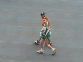 2007 Special Olympics World Summer Games: Accompanied by Shanghai Special Olympic Games volunteer Team Ireland athlete acknowledges the crowd