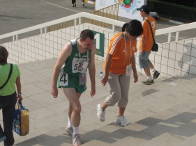 2007 Special Olympics World Summer Games: Team Ireland athlete closely accompanied by Shanghai Special Olympic Games volunteer