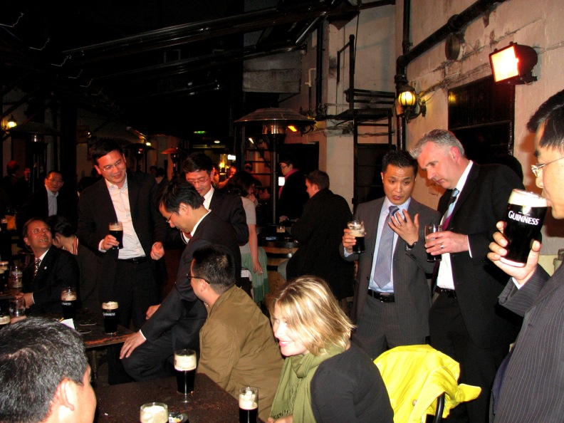 China Government officials and businessmen enjoying the craic with pints of Guinness in O'Donoghues Pub Merrion Row Dublin