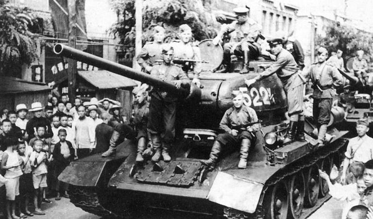 Tanks from the Soviet Red Army roll along a street in the Chinese port city of Dalian