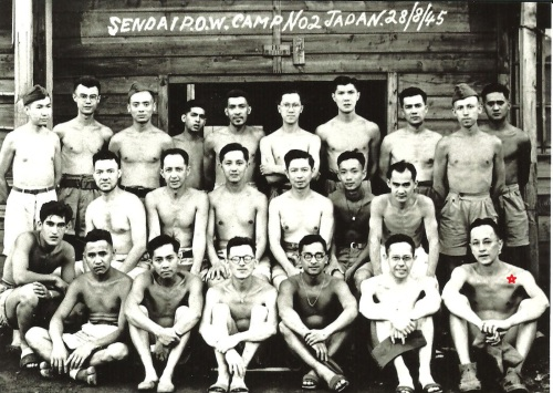 POW # 96 Private John Bernard Patrick Byrne - aka Barney - Irish Prisoner of the Japanese - at Yoshima POW Camp Sendai 2B - is seated bottom row - far right. The photograph was taken on 28th August 1945. (Source: www.mansell.com)