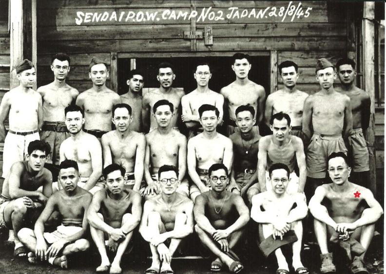 POW # 96 Private John Bernard Patrick Byrne - aka Barney - Irish Prisoner of the Japanese - at Yoshima POW Camp Sendai 2B - is seated bottom row - far right. The photograph was taken on 28th August 1945.  (Source: www.mansell.com)