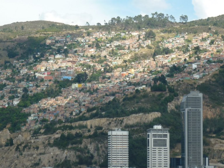Gaminos breeding grounds - Slum swellings sprawled across the hillside overlooking Bogota's northern shopping centre. According to unofficial estimates around 2,000,000 people in Bogota call such dwellings