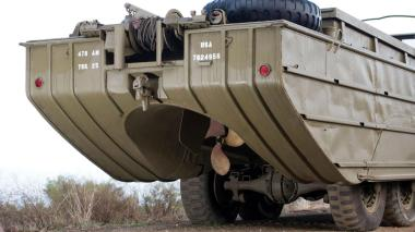 A military truck chassis, the Duck featured a slab-sided boat hull for a body and a single 25in propeller behind its rearmost axle.
